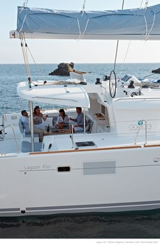 Sailing catamaran Evi - The aft sitting area and flybridge above